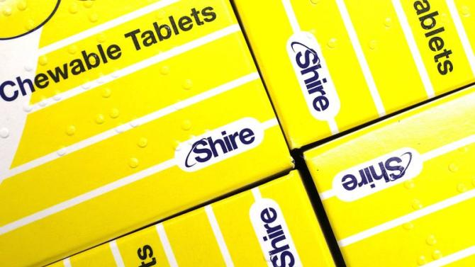 Vitamins made by Shire are displayed at a chemist's in northwest London