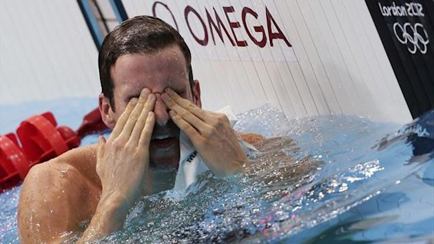 Australia&#39;s James Magnussen wipes his eyes after winning silver in the men&#39;s 100m freestyle final during the London 2012 Olympic Games at the Aquatics Centre