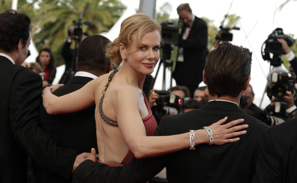 From left, actors John Cusack, Nicole Kidman and Zac Efron arrive for the screening of The Paperboy, at the 65th international film festival, in Cannes, southern France, Thursday, May 24, 2012. (AP Photo/Virginia Mayo)