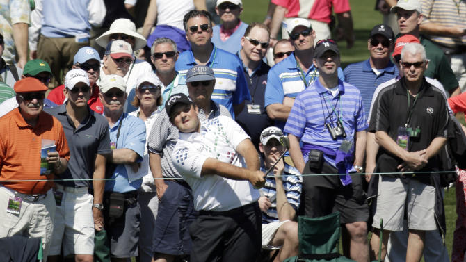 Patrick Reed watches his shot to the second green during the first round of the Masters golf tournament Thursday, April 10, 2014, in Augusta, Ga. (AP Photo/Chris Carlson)