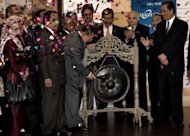 Chairman of Felda Global Ventures Holding, Berhad Mohd Isa Abdul Samad (C) strikes a gong to mark the listing debut of Felda Global at Malaysia Stock Exchange in Kuala Lumpur, on June 28. Shares in Malaysian palm oil giant jumped 18.46 percent on its stock market debut defying global economic doldrums with the world's second-largest IPO this year after Facebook