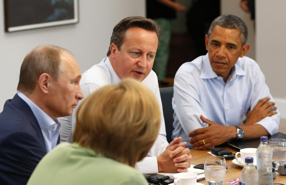 G8 leaders from left, German Chancellor Angela Merkel, Russian President Vladimir Putin, Britain's Prime Minister David Cameron and US President Barack Obama attend a working session during the G-8 summit at the Lough Erne golf resort in Enniskillen, Northern Ireland on Tuesday, June 18, 2013. (AP Photo/Yves Herman, Pool)