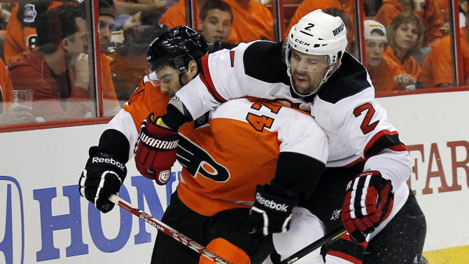 Philadelphia Flyers left wing Eric Wellwood (47) and New Jersey Devils defenseman Marek Zidlicky (2), from the Czech Republic, tangle in the second period of Game 1 in a second-round NHL Stanley Cup hockey playoff series, Sunday, April 29, 2012, in Philadelphia. (AP Photo/Alex Brandon)