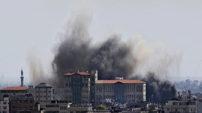 Smoke rises after an Israeli missile strike in Gaza City, Tuesday, July 15, 2014. The Israeli military says it has resumed airstrikes on Gaza after Hamas militants violated a de-escalation brokered by Egypt. (AP Photo/Adel Hana)