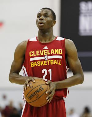 FILE - In this July 11, 2014, file photo, Andrew Wiggins of the Cleveland Cavaliers prepares to take a free throw against the Milwaukee Bucks at an NBA summer league basketball game in Las Vegas. Two people with knowledge of the deal tell The Associated Press that Minnesota and Cleveland have agreed to a trade that will send All-Star forward Kevin Love to the Cavaliers for Wiggins, Anthony Bennett and a future first-round draft pick. The two people spoke Thursday, Aug. 7, 2014, on condition of anonymity because no official agreement can be reached until Aug. 23, when Wiggins, this year's No. 1 draft pick, becomes eligible to be traded. (AP Photo/John Locher, File)