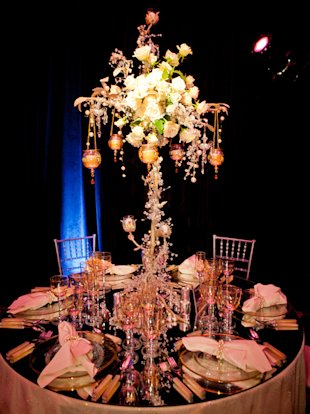 Britney Spears: The pop princess's romantic table display is accented with roses, pearls, and hanging candles. A mirrored tabletop adds a modern touch.