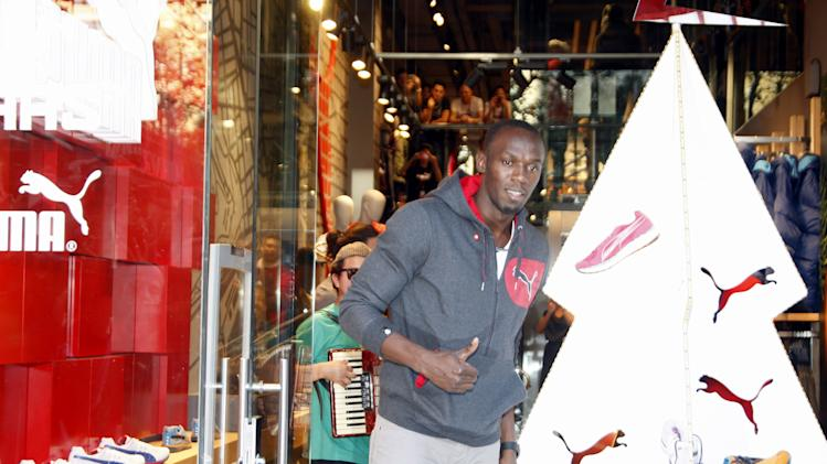 Usain Bolt Attends 'Puma Christmas Lighting' in Barcelona
