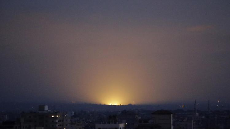 Light from an Israeli strike in central Gaza Strip illuminates the sky, as seen from Gaza City, northern Gaza Strip, Thursday, July 31, 2014. (AP Photo/Lefteris Pitarakis)