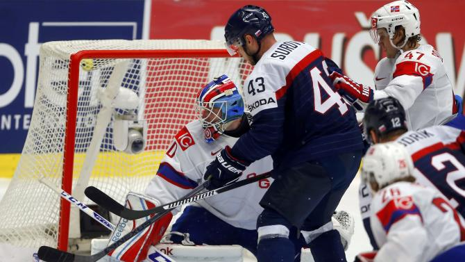 Norway's goaltender Haugen makes a save against Slovakia's Surovy during their ice hockey World Championship game in Ostrava