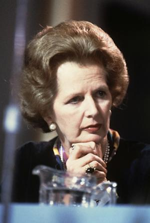 """FILE - British Prime Minister Margaret Thatcher listens to the opening debates during the Conservative Party's conference at Blackpool in this file photo dated October 1983.  Papers from 1981, released Saturday March 17, 2012, by the Margaret Thatcher archive at Cambridge University in England, reveal a thoughtful softer side to the British leader who earned her nickname """"The Iron Lady"""", and also show something of the personal relationship between Margaret and her husband Denis. (AP Photo/David Caulkin, File)"""