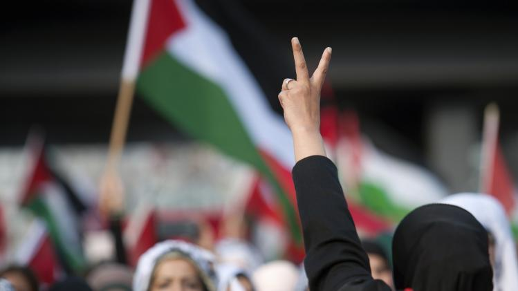 "A protester flashes a ""V"" sign during a demonstration supporting Palestine, in Berlin"