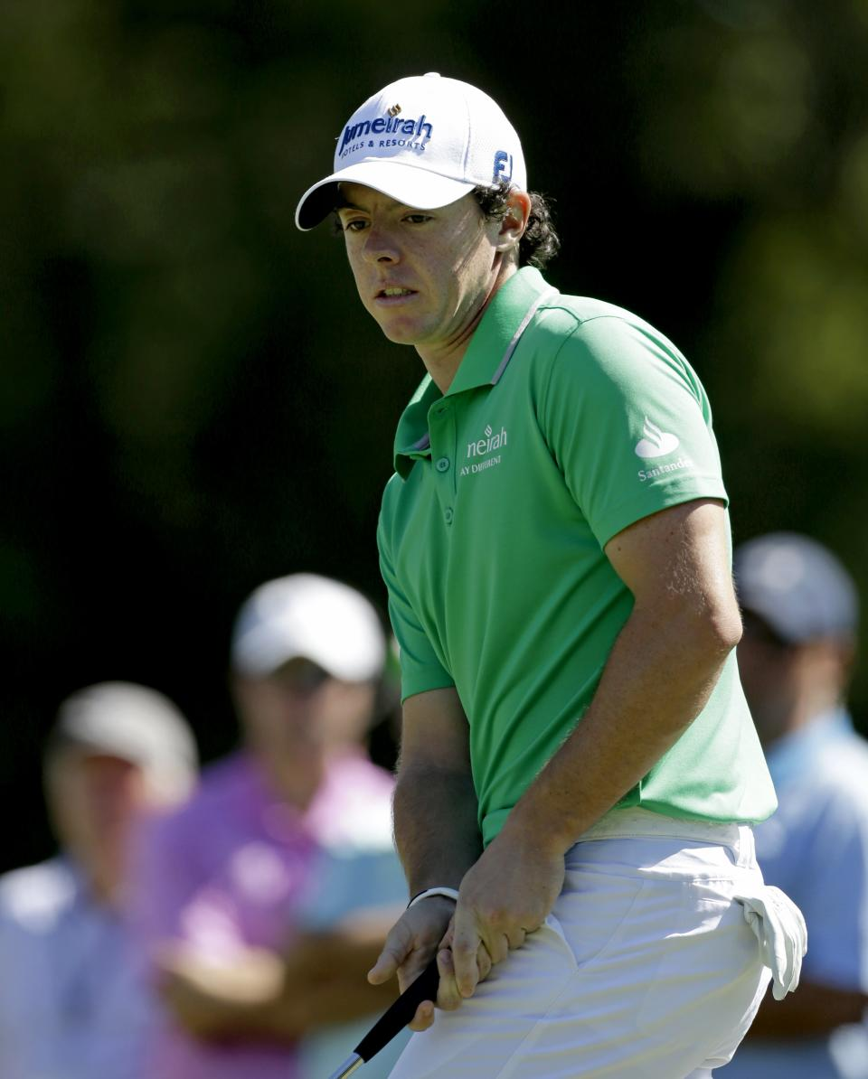Rory McIlroy, of Northern Ireland, watches his putt on the fourth hole during the final round of the Tour Championship golf tournament on Sunday, Sept. 23, 2012, in Atlanta. (AP Photo/David Goldman)