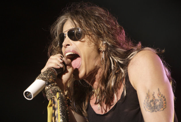 FILE- In this June 10, 2009 file photo, vocalist Steven Tyler, of the rock band Aerosmith, performs at the Verizon Wireless Amphitheater in Maryland Heights, Mo. Tyler plans to attend a legislative hearing in Hawaii on Friday, Feb. 8, 2013, on a bill that bears his name and would limit people&#39;s freedom to take photos and video of celebrities. (AP Photo/Jeff Roberson, File)