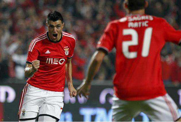 Benfica's Oscar Cardozo, left, celebrates with teammate Nemanja Matic from Serbia after scoring the opening goal against Sporting during a Portugal Cup soccer match between Benfica and Sporting at Ben