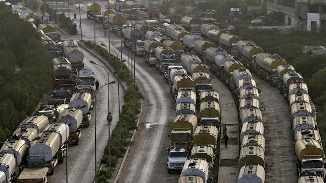 Oil tankers, which were used to transport NATO fuel supplies to Afghanistan, are parked in Karachi, Pakistan, Sunday, May 20, 2012. (AP Photo/Fareed Khan)