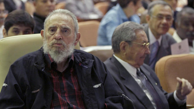Cuba's leader Fidel Castro and his brother  Cuba's President Raul Castro attend the opening session of the National Assemby in Havana, Cuba, Sunday, Feb. 24, 2012.  Cuba's parliament reconvened Sunday with new membership and was expected to name Raul Castro to a new five-year-term as president. Raul Castro fueled speculation on Friday when he talked of his possible retirement and suggested he has plans to resign at some point.(AP Photo/Ismael Francisco, Cubadebate)
