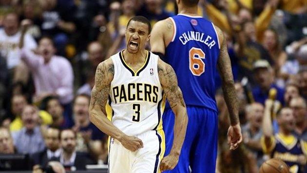 Indiana Pacers guard George Hill (3) reacts after scoring while New York Knicks center Tyson Chandler walks behind him during the second half of an NBA Eastern Conference second round playoff basketball game in Indianapolis, Indiana May 14, 2013 (Reuters)