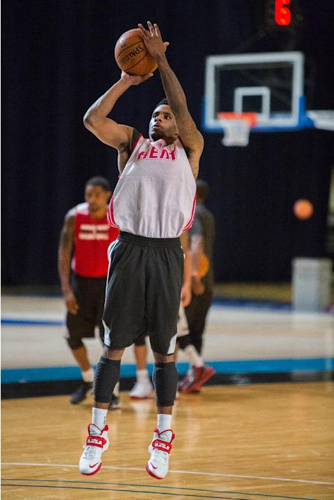 Miami Heat guard Larry Drew II  trains with his team at the Atlantis resort on Paradise Island, Bahamas, Wednesday, Oct. 2, 2013. The two-time defending NBA champions are holding a one week training c
