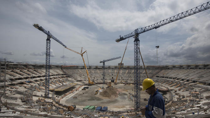 Construction continues at the Maracana soccer stadium in Rio de Janeiro, Brazil, Thursday, Nov. 8, 2012. Brazil was granted permission by FIFA on Thursday to host the Confederations Cup with six venues including Rio de Janeiro, Salvador, Recife, Brasilia, Belo Horizonte and Fortaleza, as originally planned. FIFA had previously announced the six cities as hosts, but said Recife and Salvador would only be ratified if they showed significant improvement in their preparations. (AP Photo/Felipe Dana)