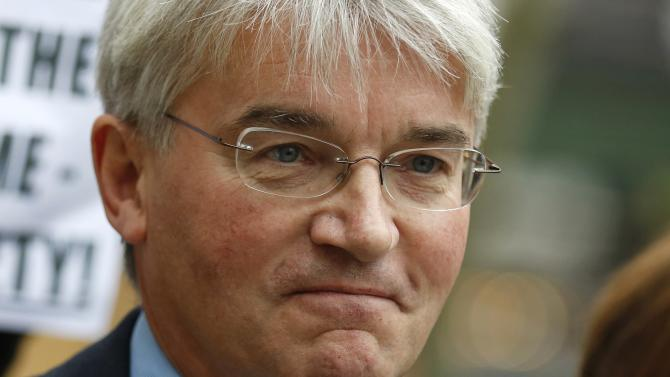 Andrew Mitchell, Britain's former Conservative Party chief whip, arrives at the Royal Courts of Justice in London