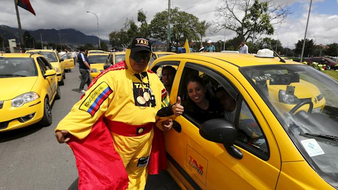 "A cab driver dressed as ""egg man"" blocks an avenue to protest against the Uber ride sharing service in Bogota"