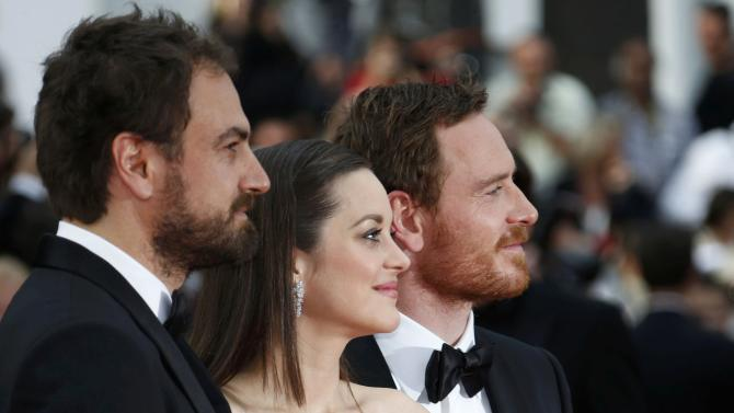 "Director Justin Kurzel, cast members Marion Cotillard and Michael Fassbender pose on the red carpet as they arrive for the screening of the film ""Macbeth"" in competition at the 68th Cannes Film Festival in Cannes"