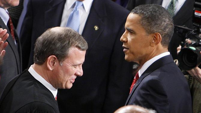 """FILE - In this Jan. 27, 2010 file photo, President Barack Obama greets Chief Justice John Roberts before he delivered his State of the Union Address on Capitol Hill in Washington. Breaking with the court's other conservative justices, Roberts announced the judgment that allows the law to go forward with its aim of covering more than 30 million uninsured Americans. Roberts explained at length the court's view of the mandate as a valid exercise of Congress' authority to """"lay and collect taxes."""" The administration estimates that roughly 4 million people will pay the penalty rather than buy insurance.  (AP Photo/Charles Dharapak, File)"""