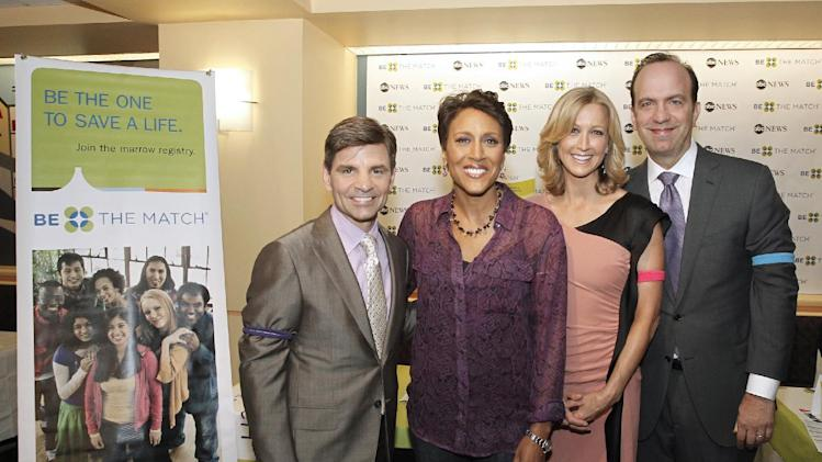 """This image released by ABC shows """"Good Morning America"""" hosts, from left, George Stephanopoulos, Robin Roberts, Lara Spencer and ABC News President Ben Sherwood at a bone marrow registry drive at ABC News headquarters in New York on Tuesday, June 26, 2012. The national bone marrow donation registry Be The Match reported Tuesday that the rate of new registrants has more than doubled since the """"Good Morning America"""" anchor Roberts announced on June 11 that she has MDS, a blood and bone marrow disease. (AP Photo/ABC, Lou Rocco)"""