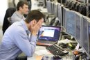 A trader reacts on the IG Group trading floor in London