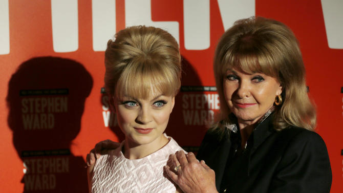 "FILE - In this Monday, Sept. 30, 2013 file photo, Mandy Rice Davies, former model and showgirl, right, poses with actress Charlotte Blackledge, who plays her in the new Andrew Lloyd Webber musical 'Stephen Ward', during the show launch photocall, in London. Mandy Rice-Davies, a key figure in Britain's biggest Cold War political scandal, the ""Profumo Affair,"" has died. She was 70. Her PR firm said Friday Dec. 19, 2014, that Rice-Davies died Thursday evening ""after a short battle with cancer."" (AP Photo/Sang Tan, File)"