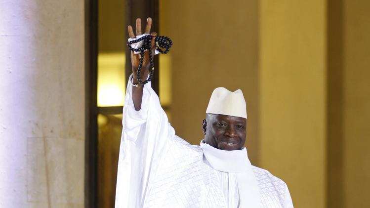 Gambia's President Yahya Jammeh arrives for a dinner with the French President and other dignitaries as part of the Summit for Peace and Security in Africa at the Elysee Palace in Paris