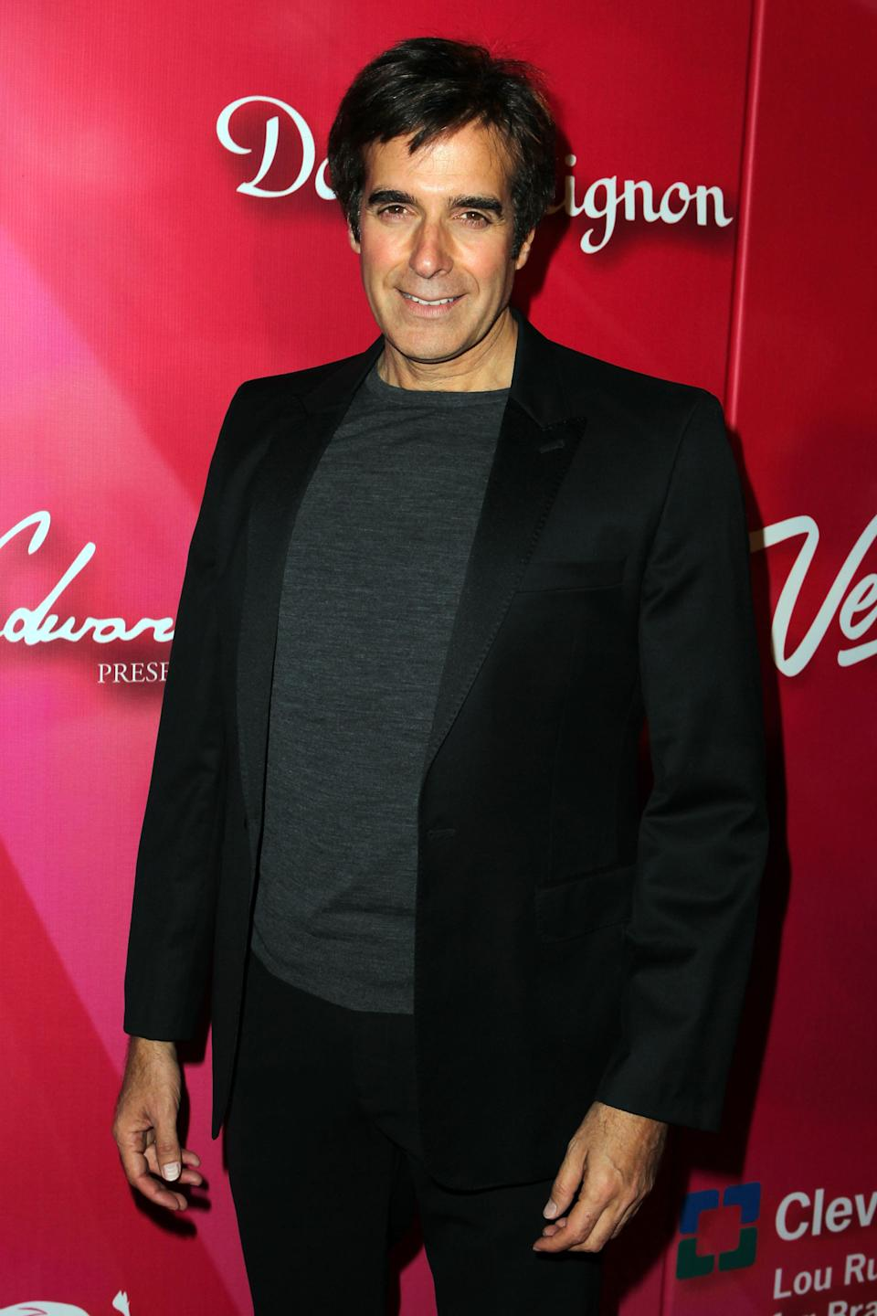 "Illusionist David Copperfield arrives at the Keep Memory Alive 16th Annual ""Power of Love Gala"" honoring Muhammad Ali with his 70th birthday celebration on Saturday, Feb. 18, 2012, in Las Vegas. (AP Photo/Jeff Bottari)"