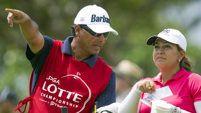 Lizette Salas, right,  of California consults with her caddie on how to hit her golf ball off the 16th tee in the third round of the LPGA Lotte Championship golf tournament at the Ko Olina Golf Club Friday, April 19, 2013, in Kapolei, Hawaii. (AP Photo/Eugene Tanner)