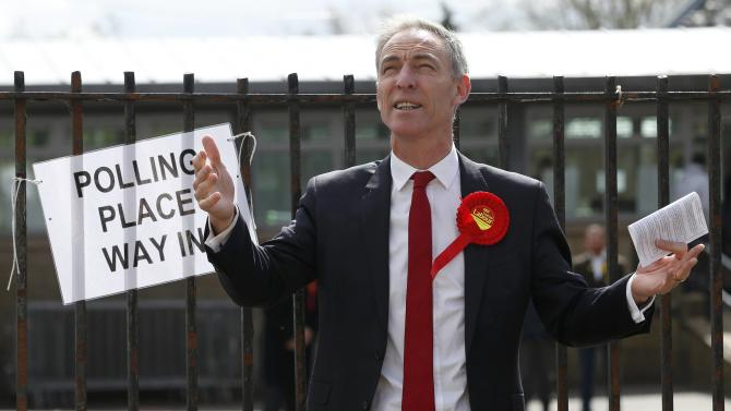 Scottish Labour Party leader Jim Murphy arrives to cast his vote in Glasgow