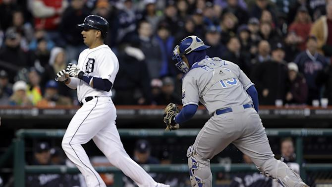 Detroit Tigers' Victor Martinez runs away from the tag of Kansas City Royals catcher Salvador Perez at home plate but was called out in the third inning of a baseball game in Detroit, Wednesday April 24, 2013. (AP Photo/Paul Sancya)