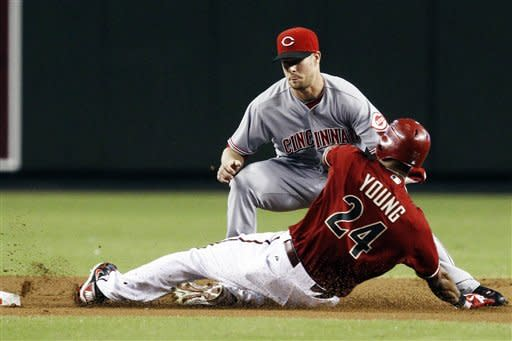 Heisey, Navarro hit HRs to rally Reds past D-backs