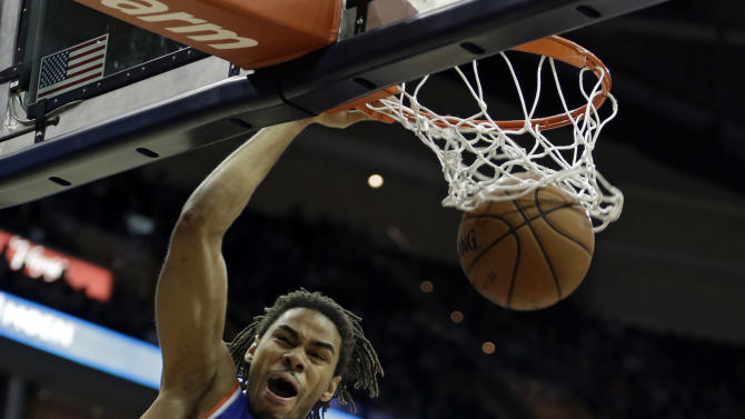 New York Knicks' Chris Copeland (14) dunks in Cleveland Cavaliers' Tyler Zeller (40) in the first quarter of an NBA basketball game on Friday, April 12, 2013, in Cleveland. (AP Photo/Mark Duncan)