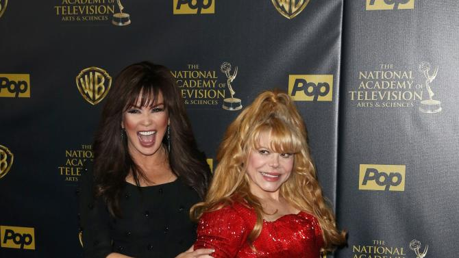 Entertainers Charo and Osmond pose backstage at the 42nd Annual Daytime Emmy Awards in Burbank