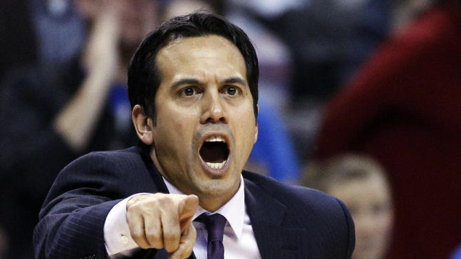 Miami Heat head coach Erik Spoelstra shouts during the fourth quarter of an NBA basketball game against the Oklahoma City Thunder in Oklahoma City, Thursday, Feb. 14, 2013. Miami won 110-100. (AP Photo/Sue Ogrocki)