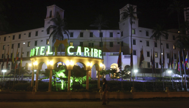 FILE - In this April 19, 2012, file photo, people walk past Hotel El Caribe in Cartagena, Colombia.  Seven Army soldiers and two Marines have received administrative punishments, but are not facing cr