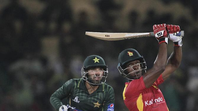 Zimbabwe's Vasimuzi Sibanda hits boundary as Pakistani wicketkeeper Mohammad Rizvan looks on during a match at the Gaddafi Stadium in Lahore, Pakistan, Sunday, May 24, 2015. The Twenty20 matches Friday and Sunday mark a return of international cricket to Pakistan for the first time since gunmen attacked buses carrying the Sri Lankan cricket team and match officials in this eastern city six years ago. Security has been beefed up for the matches. (AP Photo/K.M. Chaudary)
