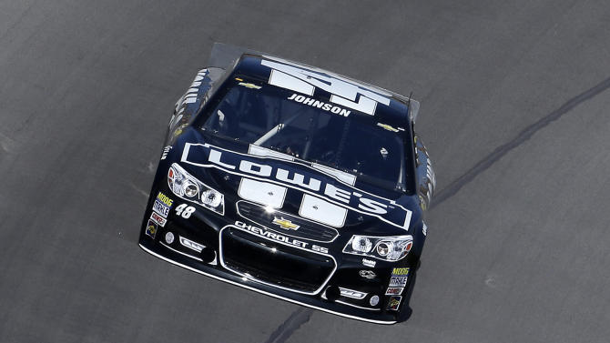 NASCAR Sprint Cup series driver Jimmie Johnson practices in his backup car for the Pure Michigan 400 auto race at Michigan International Speedway in Brooklyn, Mich., Saturday, Aug. 17, 2013. (AP Photo/Paul Sancya)