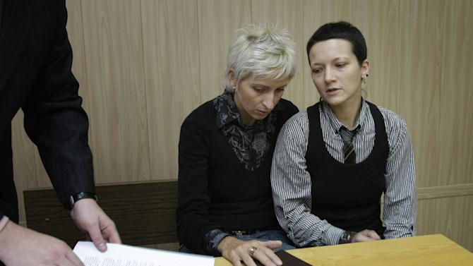 """FILE-In this Tuesday, Oct. 6, 2009 file photo Irina Fedotova-Fet, right, and Irina Shipitko are trying to register their marriage at a court in Moscow, Russia. The Tverskoi District Court upheld a decision by the city's civil registry that said Russian law defines marriage as a union of a woman and a man. A controversial bill banning """"homosexual propaganda"""" has been submitted to Russia's lower house of parliament for the first of three hearings Tuesday, Jan. 22, 2013.  (AP Photo/Ivan Sekretarev, file)"""