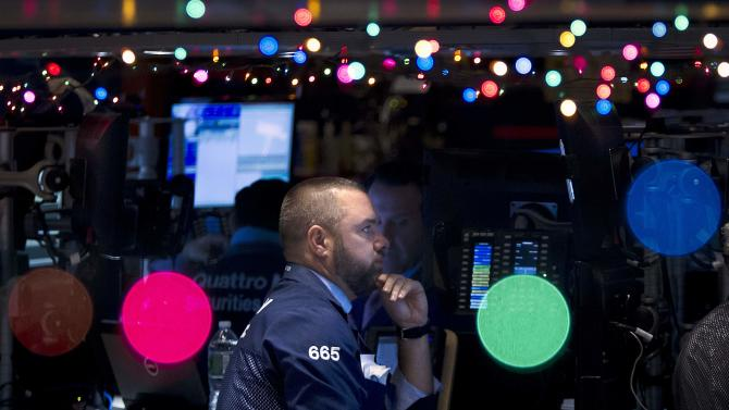 Trader Kevin Lodewick works on the floor of the NYSE, which has been decorated with Christmas lights, in New York