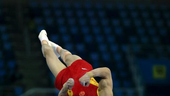 China's Huang Yuguo competes on the vault in the men's team gymnastics competition at the Namdong Gymnasium Club during the 17th Asian Games in Incheon