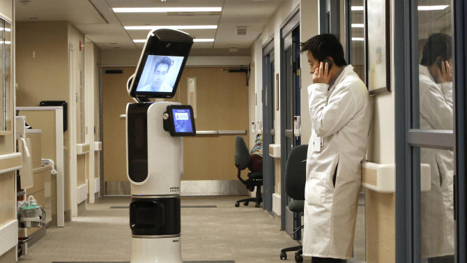 Robots let doctors 'beam' into remote hospitals