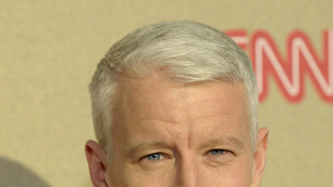 """FILE - In this Sunday, Dec. 2, 2012 file photo, reporter Anderson Cooper arrives at CNN Heroes at The Shrine Auditorium in Los Angeles. Cooper won't be in Buffalo, N.Y., to celebrate the city's heritage on Dyngus Day, a holiday that made his show's """"Ridiculist"""" and left him giggling uncontrollably on the air last year.  (Photo by Dan Steinberg/Invision/AP, File)"""