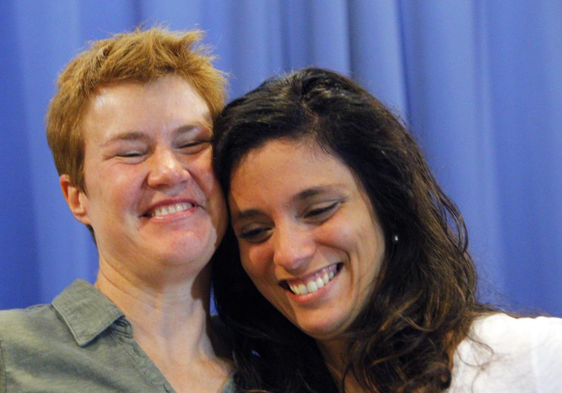 Val Tanco, right, and Sophie Jesty, plaintiffs in the Supreme Court case on gay marriage, smile during a news conference in Knoxville, Tenn. on Friday, June 26, 2015. Friday's Supreme Court ruling legalizes gay marriage nationwide, including in the 14 remaining states with bans. They moved to Tennessee for work after marrying in New York. (AP Photo/Wade Payne)