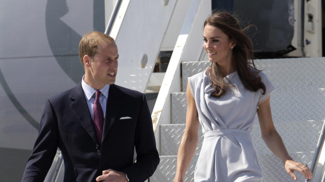 Prince William and Kate, the Duke and Duchess of Cambridge, arrive at Los Angeles International Airport in Los Angeles, Friday, July 8, 2011. (AP Photo/Jae C. Hong)