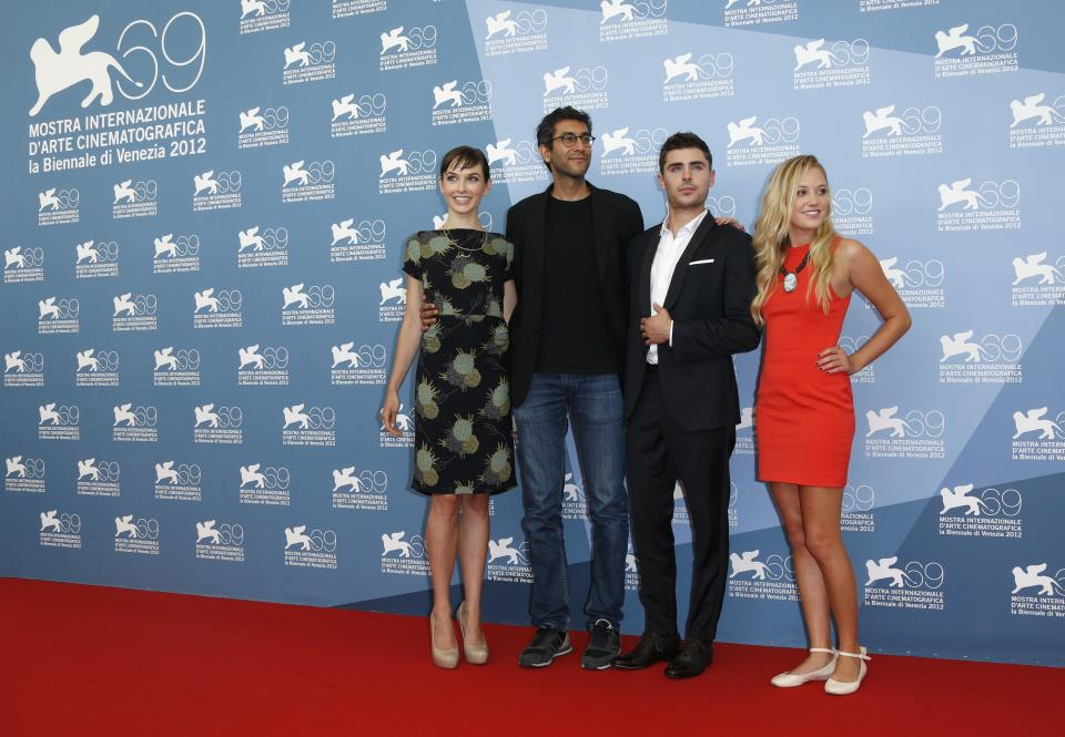 Screenwriter Hallie Elizabeth Newton, director Ramin Bahrani, actors Zac Efron and Maika Monroe pose at the photo call for the film 'At Any Price' during the 69th edition of the Venice Film Festival in Venice, Italy, Friday, Aug. 31, 2012. (AP Photo/Joel Ryan)